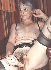 This old woman fucks her tight hole