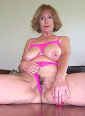 Beautiful granny in pink lingerie