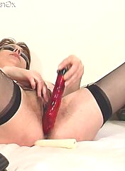 Her red dildo is getting in so hard