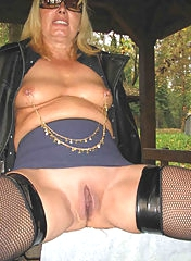 Tanned mature whore shows her snatch