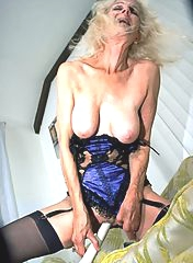 GILF with saggy tits and dildo