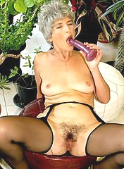 Short-haired mature slut with dildo