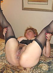 Beautiful mature is playing with her legs
