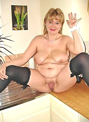 Fat mature blonde with spread legs