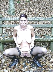 Old chick is getting naked outdoors