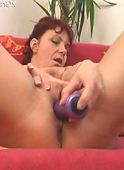 She is penetrating herself with a dildo