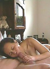 Asian mature sucking a cock