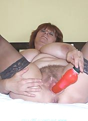 Taking a dildo very deep in her hole